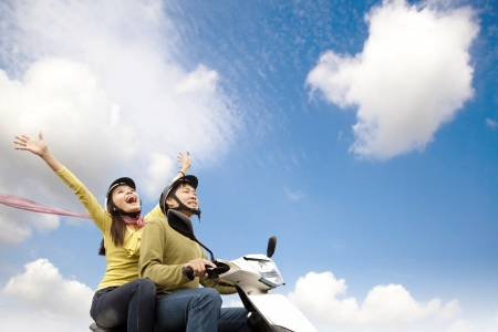Photo for Happy young couple  having fun on a scooter - Royalty Free Image