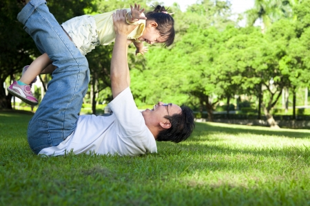 Foto per happy father and little girl on the grass - Immagine Royalty Free