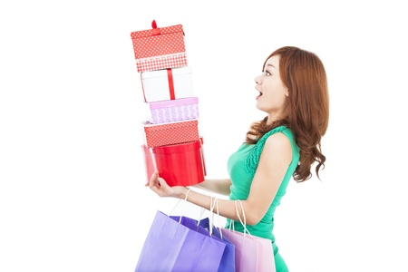 Photo for  surprised young woman holding gift box and shopping bag - Royalty Free Image