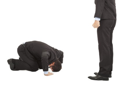 businessman apologize  to boss with japanese kneeling position