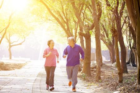 happy Senior Couple Exercising In the Park