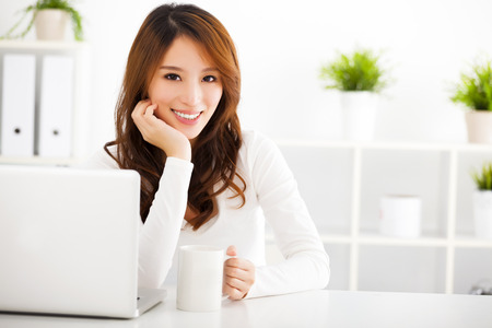 Photo for smiling Young asian woman  with laptop - Royalty Free Image