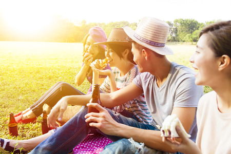 Photo for happy young friends enjoying picnic and eating - Royalty Free Image