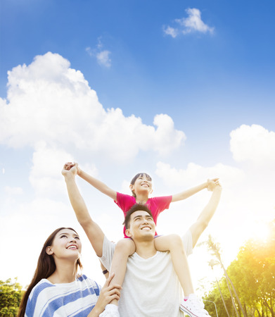 Photo for happy asian family with cloud background - Royalty Free Image