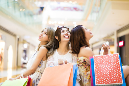 Photo for relaxed young woman holding shopping bags in the mall - Royalty Free Image