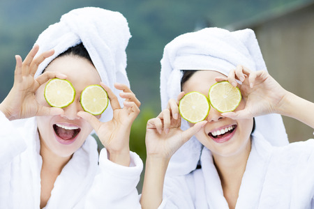 Photo for beautiful woman showing fresh lemon in spa - Royalty Free Image