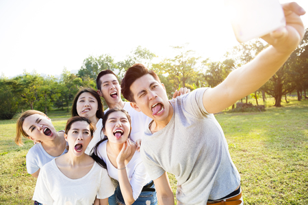 Photo for happy young group taking selfie in the park - Royalty Free Image