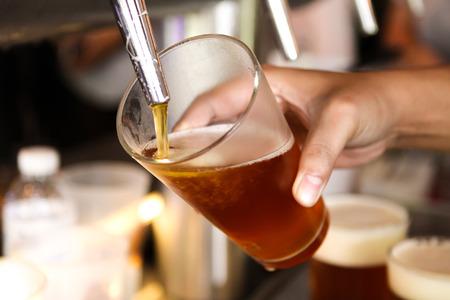 Foto de beer tap pouring a draught beer - Imagen libre de derechos