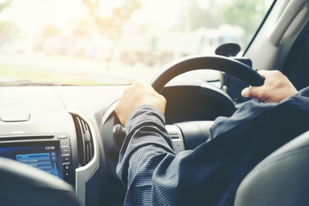 Photo for Car driver hands holding steering wheel. - Royalty Free Image