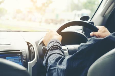 Photo pour Car driver hands holding steering wheel. - image libre de droit