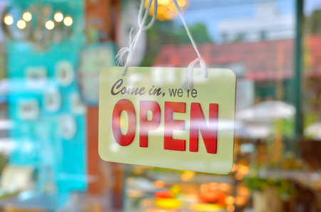 Photo for open sign broad through the glass of window at coffee shop - Royalty Free Image