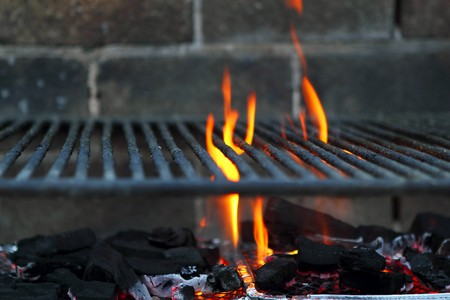 Bar b cue barbecue fire BBQ coal fire iron grill brick wall