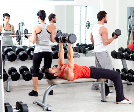 group of people in sport fitness gym weight training equipment indoor
