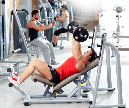 group with weight training equipment on sport gym club