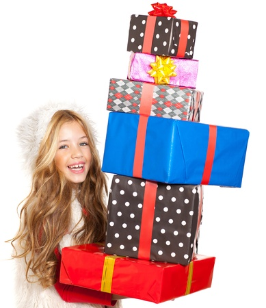 girl with christmas present gifts stacked on white background