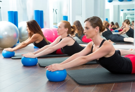 Photo for Aerobics pilates women with yoga balls in a row on fitness class - Royalty Free Image