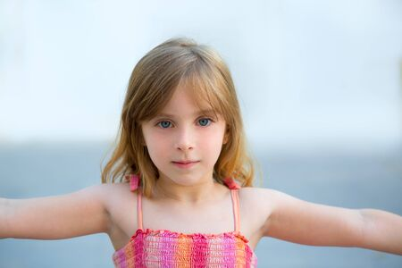 Photo for Blond kid girl open arms in outdoor with sundress - Royalty Free Image