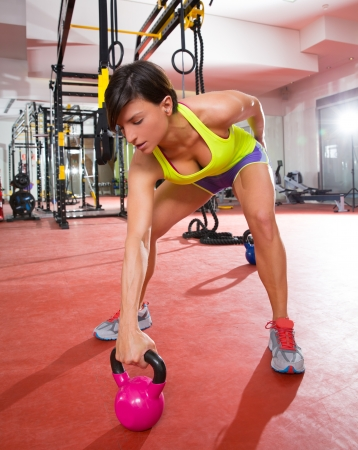 Photo for Crossfit fitness Kettlebells swing exercise woman workout at gym - Royalty Free Image