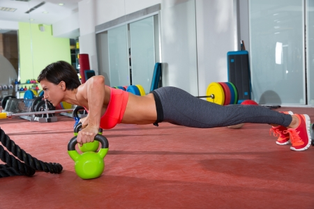 Crossfit fitness woman push ups Kettlebells pushup exercise at gym workout