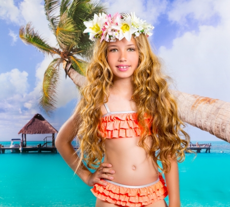 Photo for Beach tropical vacation kid blond girl with fashion flowers in head and palm tree - Royalty Free Image
