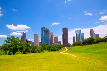 Photo for Houston Texas Skyline with modern skyscapers and blue sky view from park lawn - Royalty Free Image