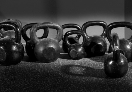 Photo pour Kettlebells weights in a workout gym in black and white - image libre de droit
