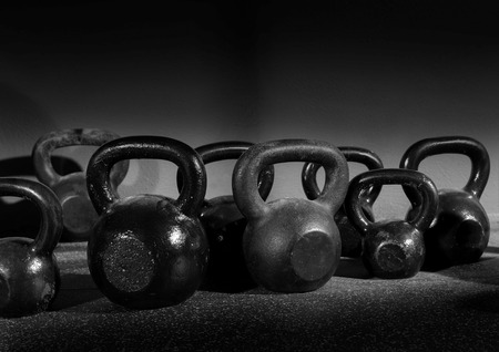 Photo for Kettlebells weights in a workout gym in black and white - Royalty Free Image