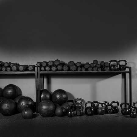 Photo for Kettlebells dumbbells and weighted slam balls weight training equipment at gym - Royalty Free Image