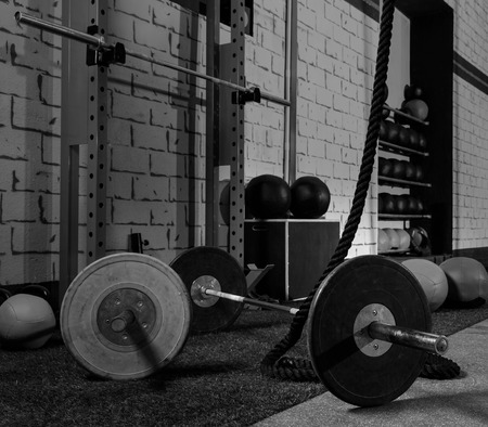 Foto de Barbells in a gym bar bells and rope at cross fit - Imagen libre de derechos