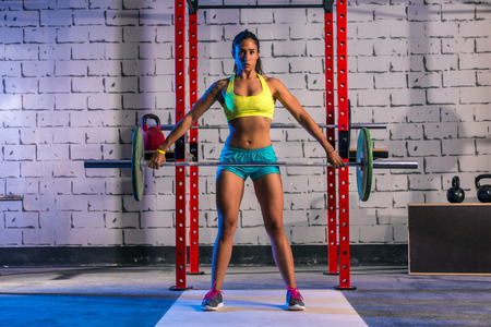Photo pour Barbell weight lifting woman weightlifting workout exercise gym - image libre de droit