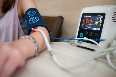 Photo for Measuring female blood pressure in a hospital - Royalty Free Image