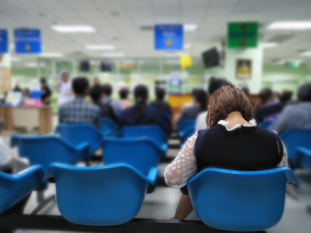 Photo pour many people waiting medical and health services to the hospital,patients waiting treatment at the hospital,blurred image of people - image libre de droit