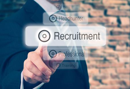 Photo pour Businessman pressing a Recruitment concept button.  - image libre de droit