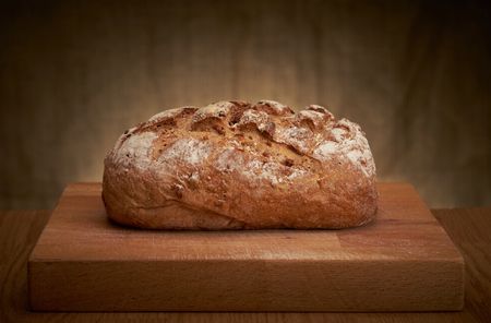 Foto de Freshly baked traditional bread on a table - Imagen libre de derechos