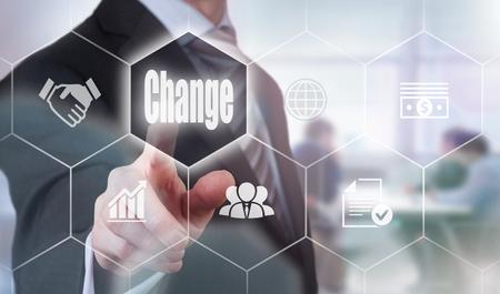 Photo pour Businessman pressing a Change concept button. - image libre de droit