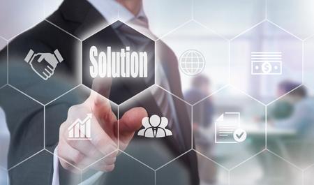 Foto de Businessman pressing a Solution concept button. - Imagen libre de derechos