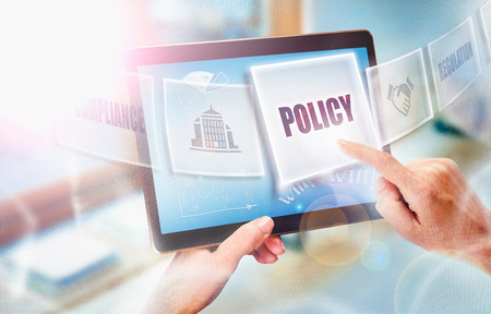 Photo pour A businesswoman selecting a Policy business concept on a futuristic portable computer screen. - image libre de droit