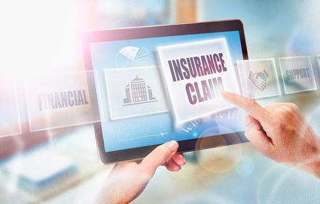 Foto de A businesswoman selecting a Insurance Claim business concept on a futuristic portable computer screen. - Imagen libre de derechos