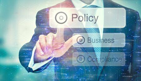 Foto de A business man selection a Policy button on a futuristic display with a concept written on it. - Imagen libre de derechos