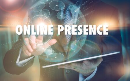 Foto per A hand selecting a Online Presence business concept on a futuristic computer display. - Immagine Royalty Free