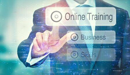 Photo pour A business man selection a Online Training button on a futuristic display with a concept written on it. - image libre de droit