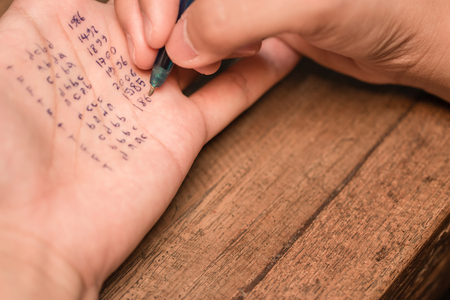 Foto de People cheating on test by writting answer on left hand - Imagen libre de derechos