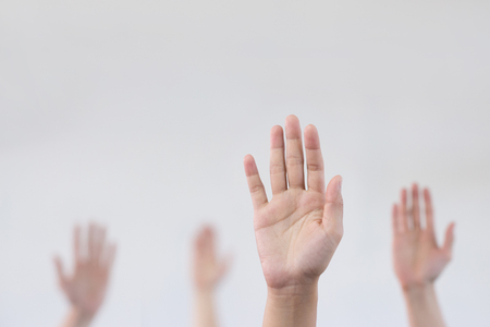 Photo for Raise hand with blurry background - Royalty Free Image