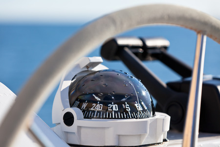 Foto de Sailing yacht control wheel and implement. Horizontal shot without people - Imagen libre de derechos