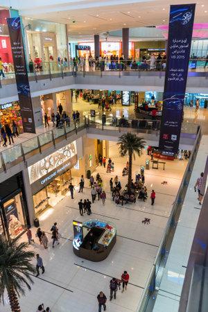 UAE, DUBAI - DECEMBER 25: people do shopping in Dubai Mall store center on December 25, 2014