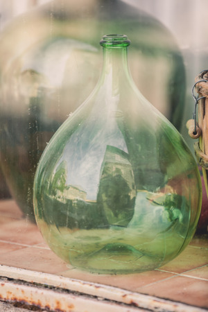 Photo for Old empty wine bottles behind the glass with street reflection - Royalty Free Image