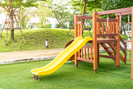 Photo pour Children kid playground with toy and slider - image libre de droit