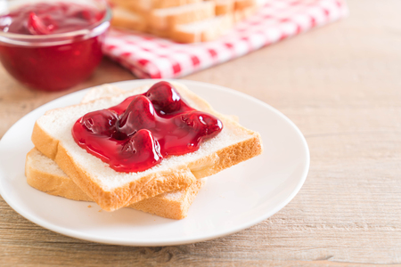 bread with strawberry jam for breakfast