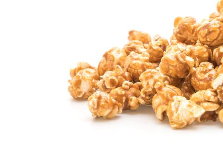 Foto de popcorn with caramel isolated on white background - Imagen libre de derechos