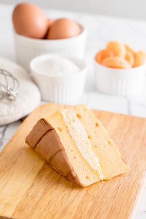 Photo for orange chiffon cake on table - Royalty Free Image